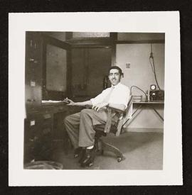 Portrait of Samuel Ajl seated in an office.
