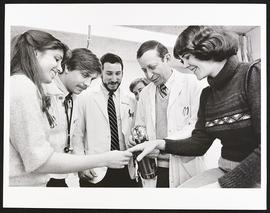 Dr. Arthur Eisen examining a patient with a group of second year students, Department of Medicine...