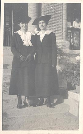 Portrait of June Stevenson and an unidentified woman wearing suits, hats, and gloves, China.