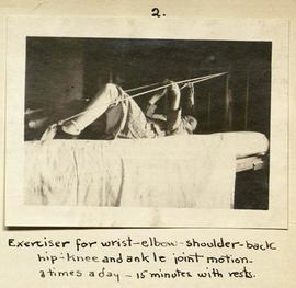 Young patient lying in bed completing arm exercises.
