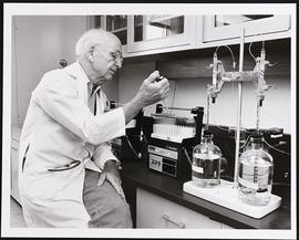 William Daughaday at work in a laboratory.