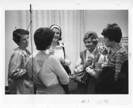 Group of five women talking at a St. Louis Children's Hospital annual meeting.