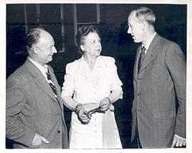 Mrs. Saysman of St. Louis speaking to two unidentified men.