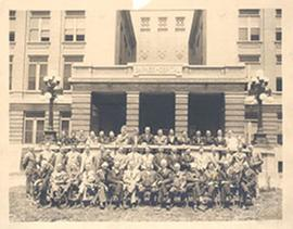 Group portrait of Barnes Hospital staff posed in front of the hospital.