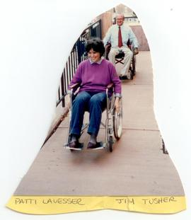 Patti LaVesser and Jim Tusher riding wheelchairs down a ramp, Washington University School of Med...