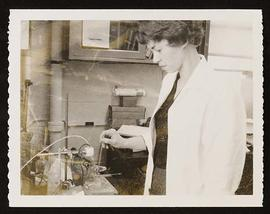 Portrait of Mary Anderson at work in a laboratory.