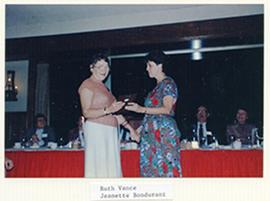 Jeanette Bondurant awarding a plaque to Ruth Vance.