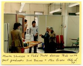 Monica Stuesse and Todd Pratt conversing with graduates Sue Barnes and Mrs. Green, Washington Uni...