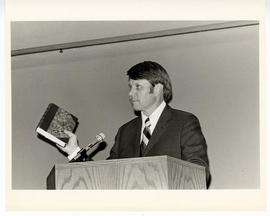 Donald R. Calvert giving an address from a podium at the Max A. Goldstein rare book collection de...