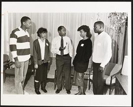 Robert Lee conversing with four recently accepted black students.