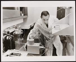 Portrait of Ralph D. Feigin at work in his laboratory.