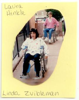 Laura Hinkle and Linda Zvibleman riding wheelchairs down a ramp, Washington University School of ...