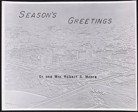 Holiday greeting card from Dr. and Mrs. Robert A. Moore depicting an aerial view of Washington Un...