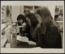 Dr. Lawrence Salkoff with two unidentified post-doctoral students and a laboratory technician, De...