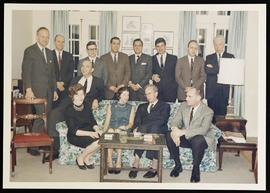 Group portrait of John D. Vavra and colleagues in Elmer Brown's living room.
