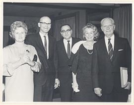 Group portrait of three unidentified people with Anne Cori and Carl F. Cori at the reception for ...