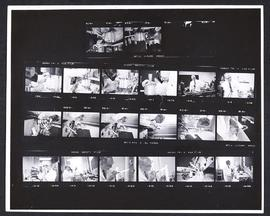 Contact sheet depicting twenty shots of Harry Huth demonstrating glass blowing techniques.
