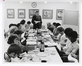 Meeting around a conference table, St. Louis Children's Hospital.