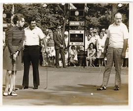 Julie Nixon Eisenhower, Lee Trevino, and Bob Hope putting at a Greater St. Louis Golf Classic.