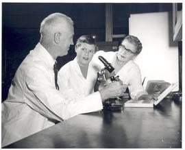 E.V. Cowdry, Adele B. Croninger, and Valentina Suntzeff gathered around a microscope, Fourth Inte...