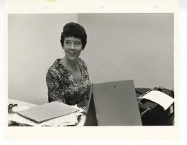 Unidentified woman sitting at a desk with a typewriter on it, St. Louis Children's Hospital.
