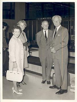 Group portrait of Anne Cori, Carl F. Cori, and an unidentified man and woman standing next to a b...