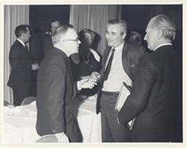 Carl F. Cori conversing with two unidentified men at the reception for the first Cori Lecture, Ro...