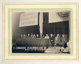 View of the speakers' panel lined up onstage at the First Panamerican Congress of Gerontology in ...
