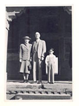 Alice and E.V. Cowdry and an unidentified child on stone steps.