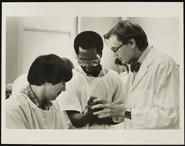 Dr. Roy Peterson and two students, Department of Anatomy, Washington University School of Medicine.