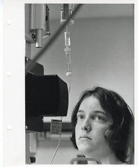 Unidentified nurse checking an I.V. tube, St. Louis Children's Hospital.