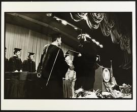 Samuel B. Guze presenting a student with his diploma at Commencement, Washington University Schoo...