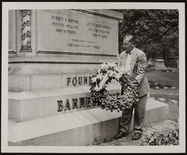 "Frank R. Bradley placing a wreath in front of Robert A Barnes"" tomb."