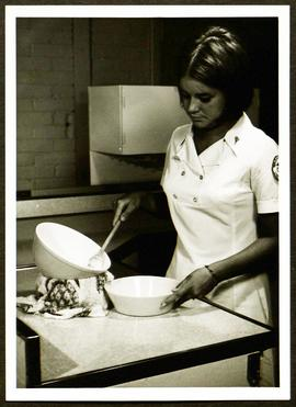 Student using mixing bowls, Washington University School of Medicine, Program in Occupational The...