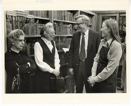 Two unidentified women conversing with Norman Wolff, Jr. and Laurie Miller at the Max A. Goldstei...