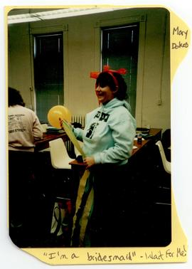 Mary Dokes holding streamers, Washington University School of Medicine, Program in Occupational T...