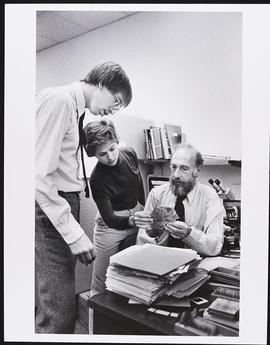Dr. Charles Kuhn with fourth year student Susan Rollins and an unidentified man, Department of Pa...