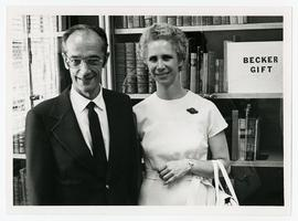 Portrait of Bernard and Janet Becker posed in front of the Becker Rare Book Collection, Washingto...