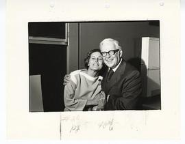 Marian Alexander and C. Alvin Tolin embracing.