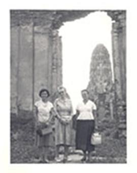 Group portrait of Alice Cowdry and two unidentified women at a temple site, China.