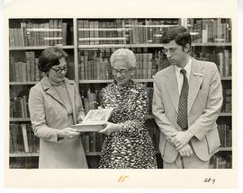 Judith Overmier, Estelle Brodman, and Mark Weimer examining a book from the Max A. Goldstein rare...