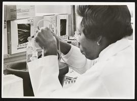 Unidentified woman at work in a laboratory.