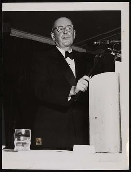 Edward D. Churchill speaking at a podium.