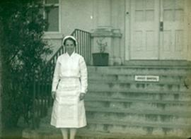 Portrait of 1st Lieutenant Lucille S. Spalding in front of the Main Nurses' Quarters, Fort Bennin...