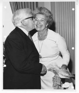 C. Alvin Tolin kissing the cheek of Lucille Osterkamp.