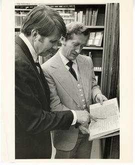 Donald R. Calvert and David P. Pascoe examining a book from the Max A. Goldstein rare book collec...