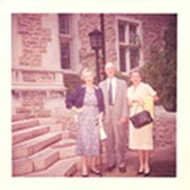 Group portrait of Alice and E.V. Cowdry with an unidentified woman near the steps of a building.