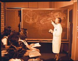 Woman giving a lecture to students, Washington University School of Medicine, Program in Occupati...