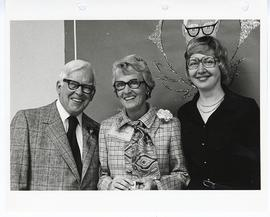 Group portrait ot C. Alvin Tolin, an unidentified woman, and Doris England at an appreciation party.