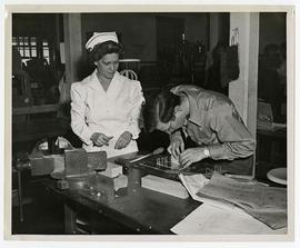 Occupational Therapist supervising a patient in a workshop, Wakeman General and Convalescent Hosp...